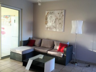 Location vacances Appartement Saint-François: le salon ...<br />