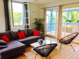 Location Appartement Saint-Martin - le salon ouvert sur la terrasse