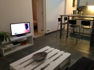 Location Appartement Saint-Martin - Coin salon avec TV