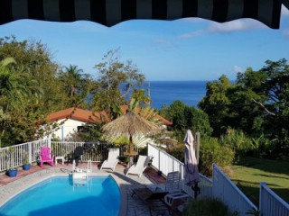 Location Bungalow Guadeloupe : vue mer, piscine, climatisation, internet