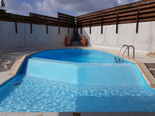 Location vacances Villa Gosier: Piscine ...<br />