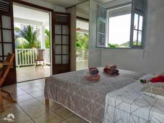 Location Villa Martinique - Chambre 1 - Grand lit - Balcon