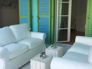 Location Villa Saint-Martin - le coin salon sur la terrasse couverte